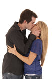 Young couple kissing side view Royalty Free Stock Image