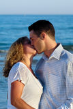 Young couple are kissing. Royalty Free Stock Photography
