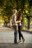 Young couple kissing on the street Stock Photo