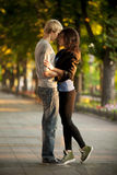 Young couple kissing on the street Stock Photography