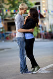 Young couple kissing on the street Stock Images