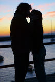 A young couple kissing at sunset Royalty Free Stock Photography