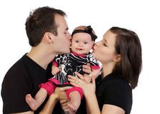 Young Couple Kissing Their Baby Girl Royalty Free Stock Photo