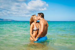 Young Couple Kissing on Tropical Beach Stock Photography