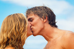 Young Couple Kissing on Tropical Beach Royalty Free Stock Photo