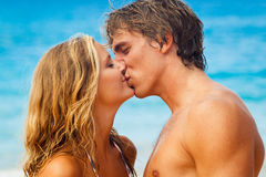 Young Couple Kissing on Tropical Beach Royalty Free Stock Image