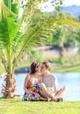 Young couple kissing in a tropical garden Royalty Free Stock Photo