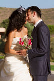 Young couple kissing after wedding Royalty Free Stock Photography
