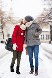 Young couple kissing on winter day Stock Photos