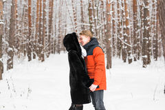 Young couple kissing on winter day Royalty Free Stock Photo