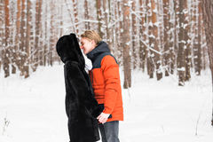 Young couple kissing on winter day Royalty Free Stock Image