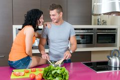 Young couple in the kitchen Royalty Free Stock Photo