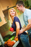 A young couple in kitchen Stock Images