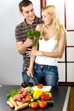Young couple at the kitchen Royalty Free Stock Photo