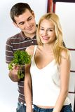 Young couple at the kitchen Royalty Free Stock Photography
