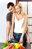 Young couple at the kitchen Royalty Free Stock Images