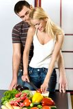 Young couple at the kitchen Stock Images