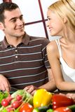 Young couple at the kitchen Royalty Free Stock Image