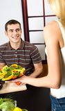 Young couple at the kitchen Royalty Free Stock Photos