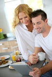 Young couple in kitchen Stock Image