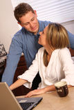 Young couple on a kitchen Stock Photography