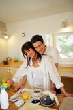 Young couple in the kitchen. Young man with young woman standing in the kitchen Stock Image