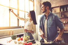 Young couple in kitchen Royalty Free Stock Image