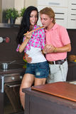 Young couple in the kitchen Royalty Free Stock Photography