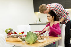 Young couple in the kitchen Royalty Free Stock Image