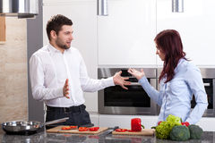 Young couple at kitchen Royalty Free Stock Images