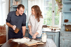 Young couple in the kitchen playing with flour Stock Photography