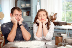 Young couple in the kitchen playing with flour Royalty Free Stock Photos