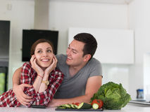 Young couple in the kitchen Stock Images