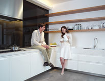 Young couple in the kitchen zx Stock Images