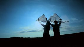 Young Couple With Kites At Nature stock video footage
