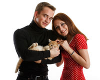 Young couple with a kitten. Stock Images