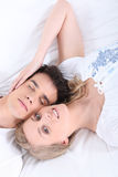 Young couple laid on a bed Royalty Free Stock Image
