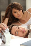 Young couple laid in bed Royalty Free Stock Image