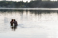 Young couple in the lake Royalty Free Stock Image