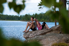 Young couple at the lake shore Royalty Free Stock Image