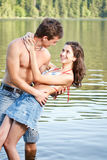 Young couple in lake water Royalty Free Stock Image