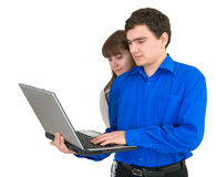 Young couple with the laptop. In hands Royalty Free Stock Photos