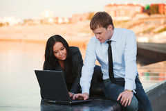 Young couple with laptop. Royalty Free Stock Image