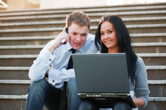 Young couple with laptop. Stock Photo