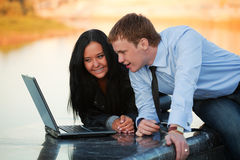 Young couple with laptop. Royalty Free Stock Photos