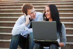 Young business couple using laptop Stock Images