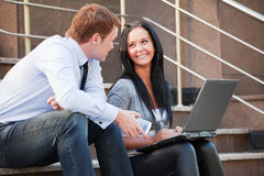 Young couple with laptop. Royalty Free Stock Photography