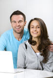 Young couple with laptop Royalty Free Stock Image