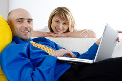 A Young Couple and a Laptop Stock Photo
