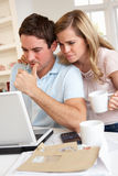 Young couple at a laptop computer Stock Photo